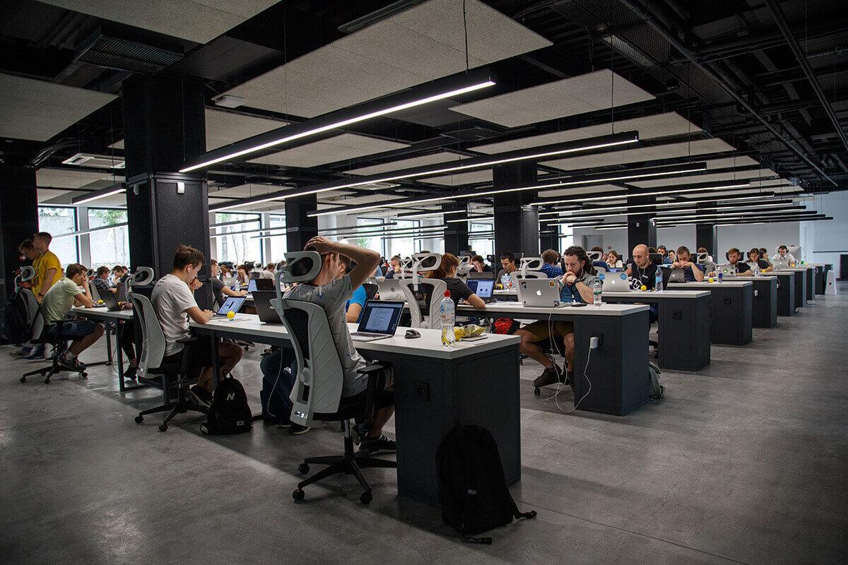 People working on their computers in large open space office